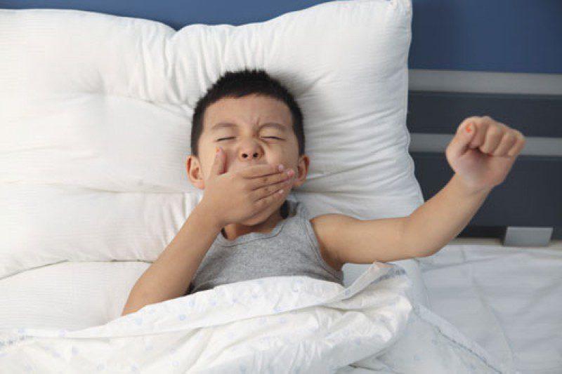 a boy waking up
